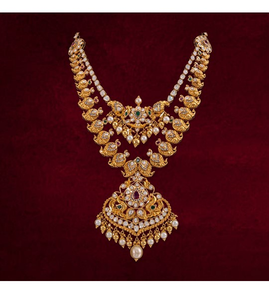Gold with polki multi-stone necklace with south sea