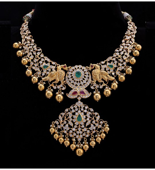 Diamond studded gold twin peacock necklace