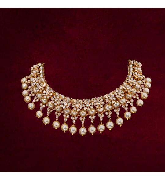 Gold necklace with flower shaped  Polki diamonds with pearl drops
