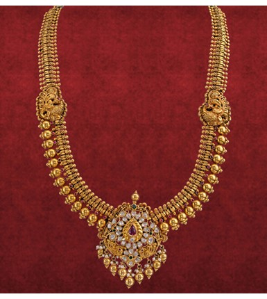 Gold necklace with Polki diamond and ruby centered pendant